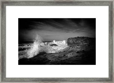Surf Ramming Rocks Framed Print by Ron Regalado