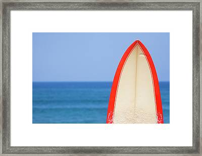 Surfboard By Sea Framed Print by Alex Bramwell