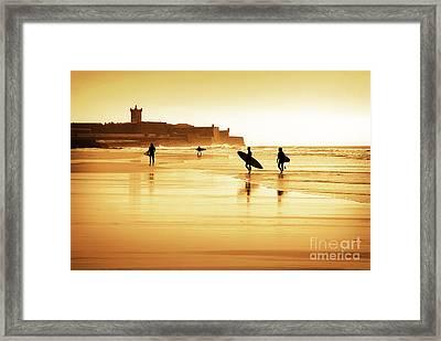 Surfers Silhouettes Framed Print by Carlos Caetano
