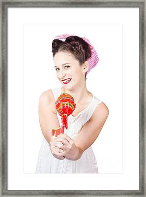 Sweet Lolly Shop Lady Offering Over Red Lollipop Framed Print by Jorgo Photography - Wall Art Gallery