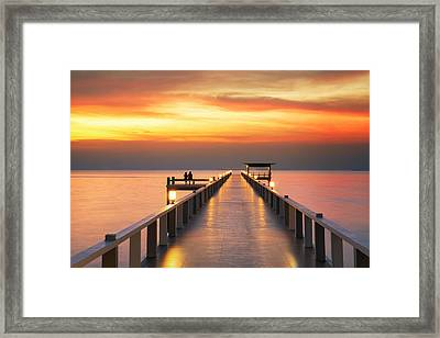 Sweetheart On Wooded Bridge With Sunset Framed Print by Anek Suwannaphoom