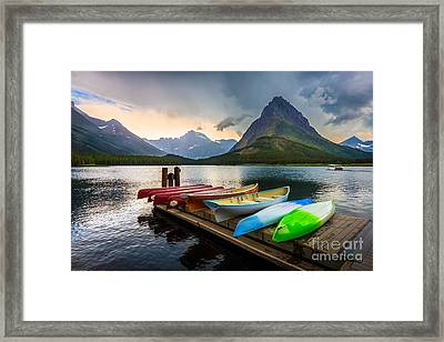 Swiftcurrent Canoes Framed Print by Inge Johnsson