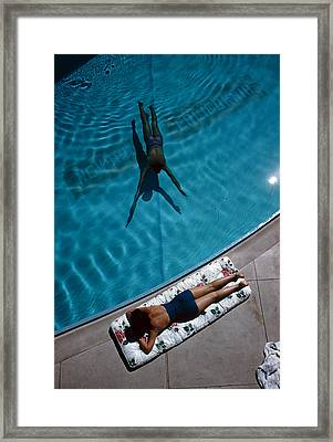 Swimmer And Sunbather Framed Print by Slim Aarons