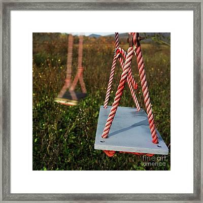 Swings Framed Print by Bernard Jaubert