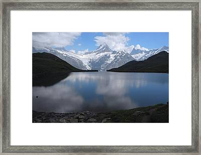 Swiss Alps And Clouds Casting Framed Print by Anne Keiser