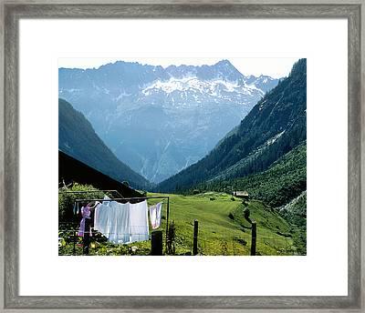 Swiss Laundry Framed Print by Joe Bonita