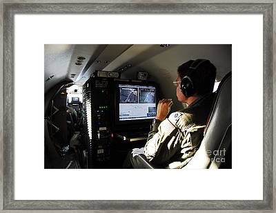 System Operator Operates A Console Framed Print by Stocktrek Images