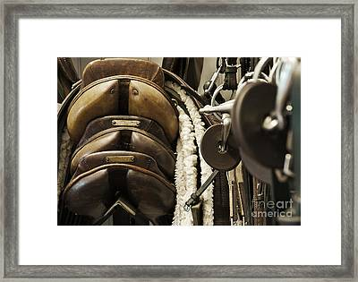 Tac Room Saddles Framed Print by John Greim
