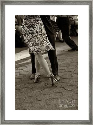Tango In The Park Framed Print by Leslie Leda