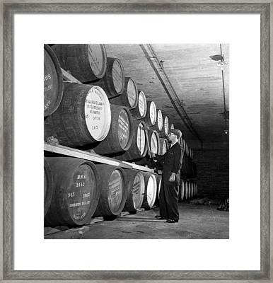 Tapping Casks Framed Print by George Konig