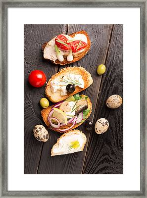 Tasty Tapas On A Wooden Black Table  Framed Print by Vadim Goodwill