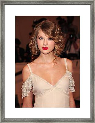 Taylor Swift Wearing A Dress By Ralph Framed Print by Everett