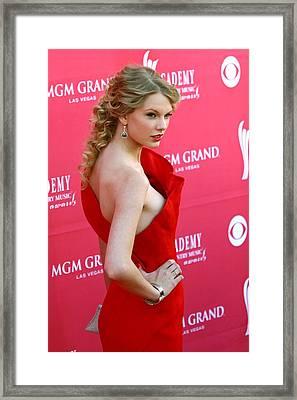 Taylor Swift Wearing An Angel Sanchez Framed Print by Everett