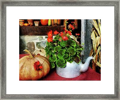 Teapot Filled With Geraniums Framed Print by Susan Savad