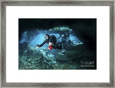 Technical Divers Enter The Cavern Framed Print by Karen Doody