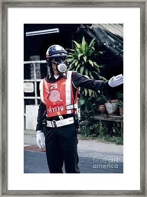 Thai Traffic Officer Framed Print by Inga Spence