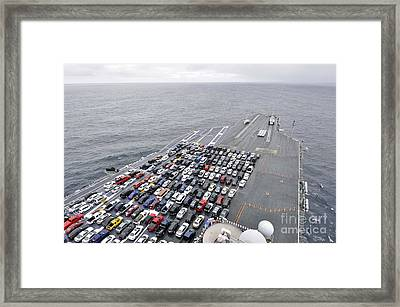 The Aircraft Carrier Uss Ronald Reagan Transports Sailors Vehicles. Framed Print by Celestial Images