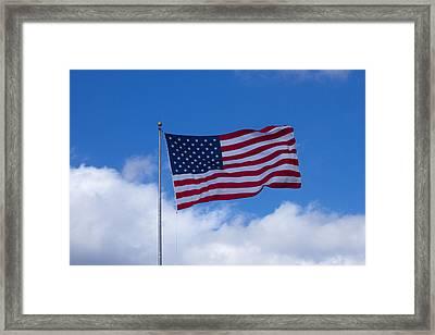 The America Flag Waves On Framed Print by Reid Callaway