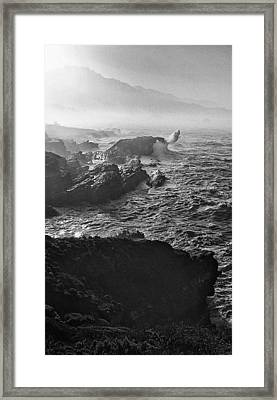 The Angry Coastline Framed Print by Ron Regalado