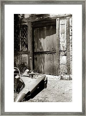 The Blacksmith's Door Framed Print by Robert Lacy