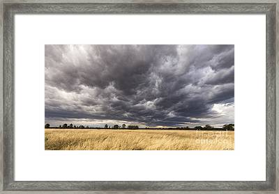 The Calm Before The Storm Framed Print by Linda Lees