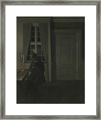 The Collector Of Coins Framed Print by Vilhelm Hammershoi