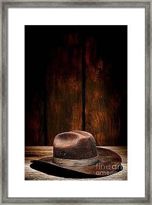 The Dirty Brown Hat Framed Print by Olivier Le Queinec