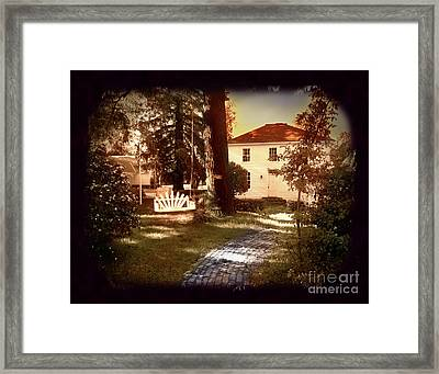 The Empty Swing Framed Print by Laura Iverson