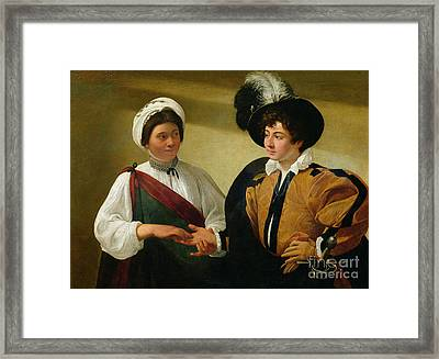 The Fortune Teller Framed Print by Michelangelo Merisi da Caravaggio