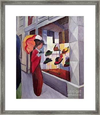 The Hat Shop Framed Print by August Macke
