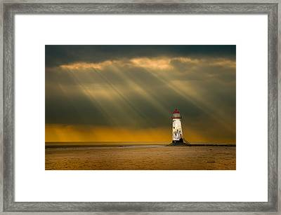 The Lighthouse As The Storm Breaks Framed Print by Meirion Matthias