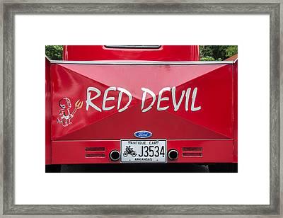 The Little Red Devil Framed Print by Robert Kinser