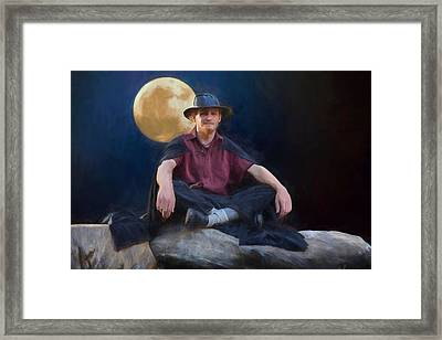 The Man And The Moon Framed Print by John Haldane