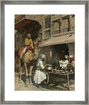 The Metalsmith's Shop  Framed Print by Edwin Lord Weeks