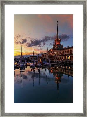 the nautical station and the yacht on the main sea channel of the Sochi seaport Framed Print by George Westermak