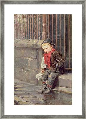 The News Boy Framed Print by Ralph Hedley