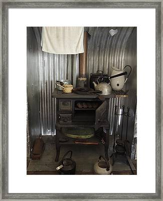 The Old Wood Stove. Framed Print by Denise Clark