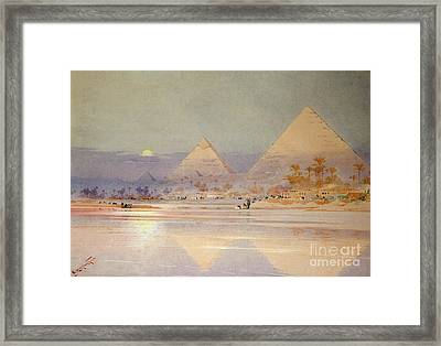 The Pyramids At Dusk Framed Print by Augustus Osborne Lamplough