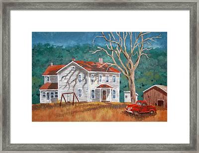 The Red Swing Framed Print by Tony Caviston