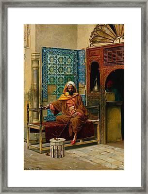 The Smoker Framed Print by Ludwig Deutsch