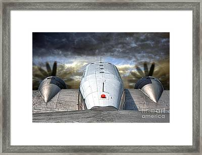 The Takeoff Framed Print by Olivier Le Queinec
