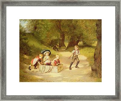 The Toy Carriage Framed Print by Harry Brooker