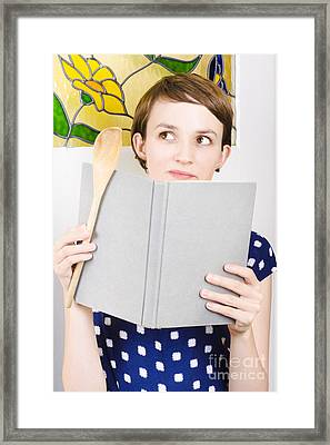 Thinking Woman Reading Cookbook In Kitchen Framed Print by Jorgo Photography - Wall Art Gallery