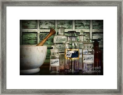 Those Old Pharmacy Bottles Framed Print by Paul Ward