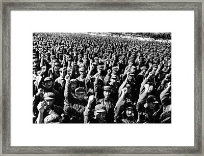 Thousands Of Red Army Soldiers Raise Framed Print by Everett