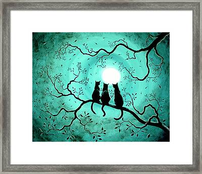 Three Black Cats Under A Full Moon Framed Print by Laura Iverson