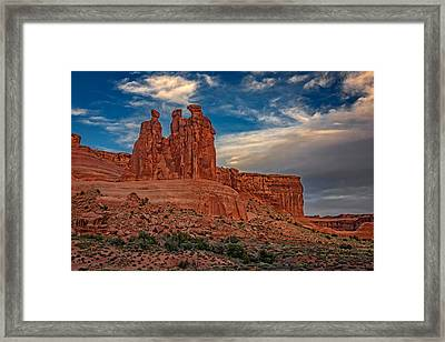 Three Gossips In Arches Framed Print by Rick Berk