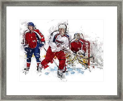 Three Hockey Players At The Goal Framed Print by Elaine Plesser