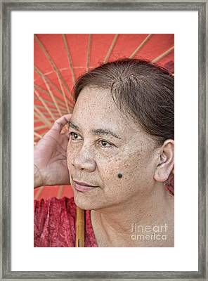 Three Quarter Portrait Of A Freckle Faced Filipina With A Mole On Her Cheek  Framed Print by Jim Fitzpatrick