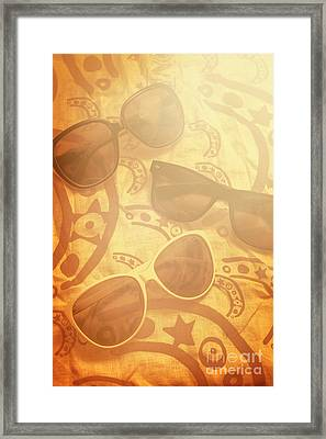 Three Sunglasses On Patterned Cloth Framed Print by Jorgo Photography - Wall Art Gallery